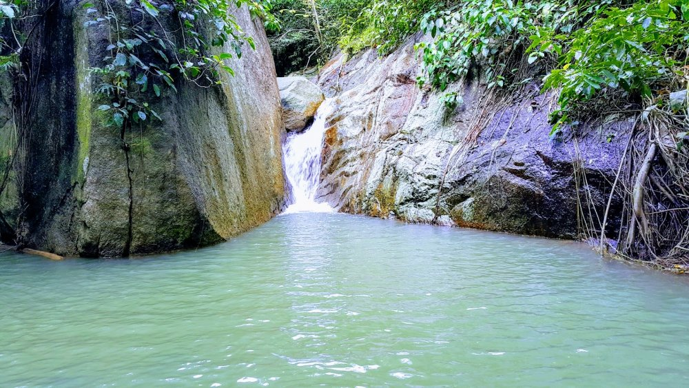 Swim in a beautiful waterfall